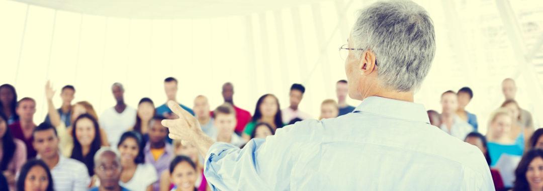 A parent educator teaches a group of parents